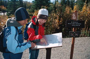 Denali National Park Visitors check out a trail map
